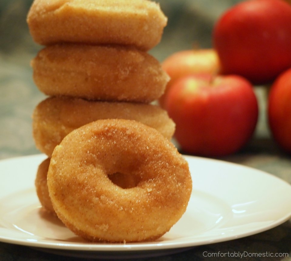 Baked Apple Cinnamon Doughnuts | ComfortablyDomestic.com are soft, delicious doughnuts with fresh apples inside and a sweet cinnamon sugar coating. Recipe includes directions to make as muffins, too!