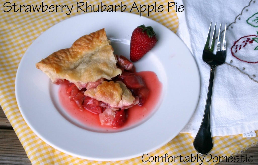 Strawberry rhubarb apple pie bakes fresh strawberries, rhubarb, and apples into a tender, buttery crust. The perfect trio of flavors for a spectacular dessert! | ComfortablyDomestic.com