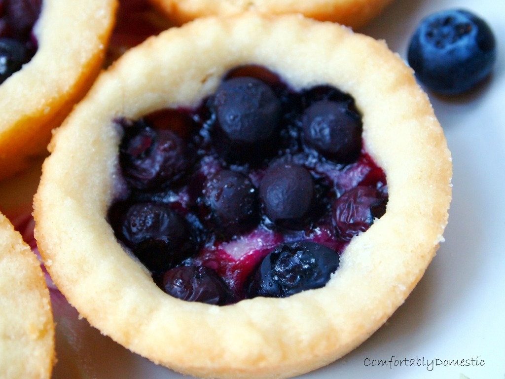 Blueberry shortbread pies are bite sized shortbread, bursting with sweet blueberry filling. They're a taste of summer any time of the year. | ComfortablyDomestic.com