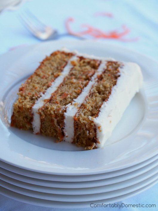 Delicately spiced carrot cake, loaded with finely shredded carrots and a tender crumb, enrobed in a fluffy crystallized ginger cream cheese frosting.   ComfortablyDomestic.com